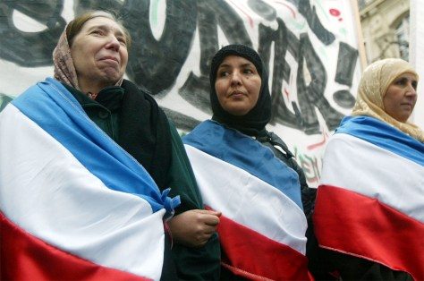 Muslims Rally Against France's Ban On Religious Headscarves