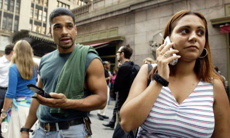 Cell phone users stand outside Grand Central Station in New York