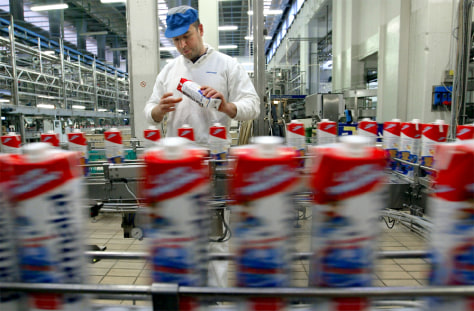 WORKER INSPECTS BOTTLED MILK INSIDE PARMALAT'S MAIN FACTORY AT COLLECCHIO