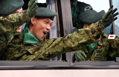 JAPANESE SOLDIERS WAVE FROM BUS AS THEY LEAVE ARMY GARRISON IN ASAHIKAWA