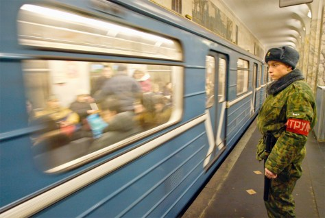 Image: Russian Interior Ministry soldier patrols Moscow subway station.