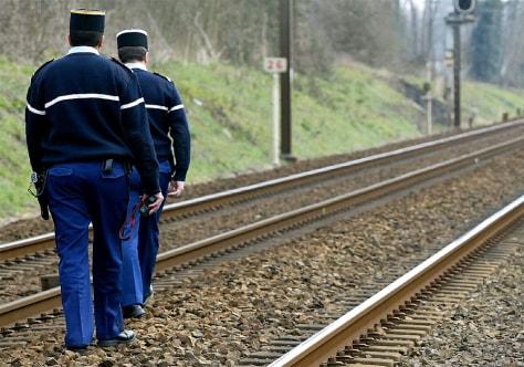 IMAGE: FRENCH GENDARMES PATROL RAIL TRACKS IN SOUTHWESTERN FRANCE AFTER BOMBING ALERT