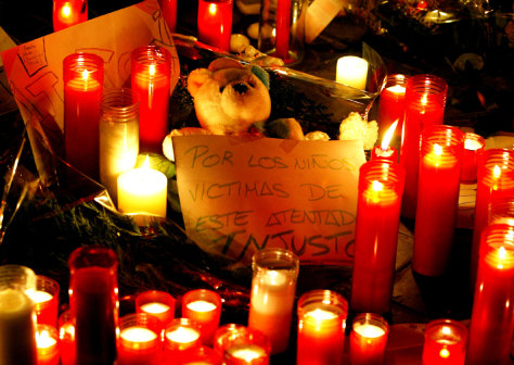 TEDDY BEAR AMID CANDLES PLACED AT SCENE OF MADRID TRAIN BOMBINGS