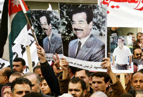 DEMONSTRATORS CARRY PICTURES OF TOPPLED IRAQI PRESIDENT HUSEIN IN AMMAN
