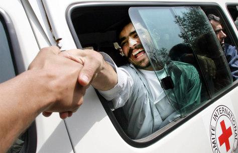 FORMER GUANTANAMO BAY PRISONER SHAKES HANDS