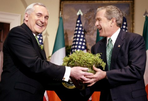 US PRESIDENT GEORGE W. BUSH IS HANDED SHAMROCK DURING A CEREMONY WITH BERTIE AHERN IN WASHINGTON