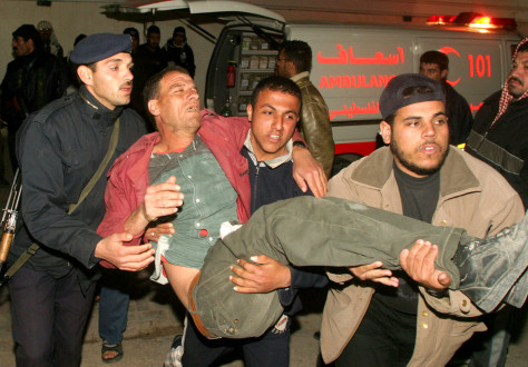 Image: Palestinian wounded in Israeli missile strike.