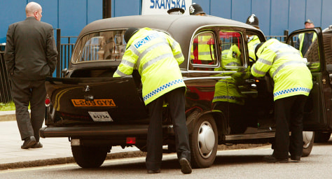 Image: London police search taxi.