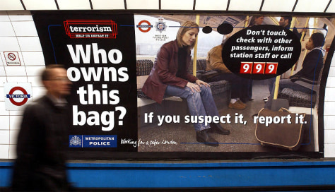 POSTER ASKING MEMBERS OF PUBLIC TO REPORT SUSPECT BAGS IS SEEN AT VICTORIA UNDERGROUND STATION LONDON