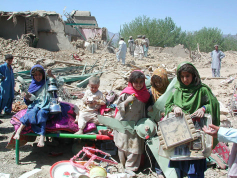 Image: Residents of the area around Wana, Pakistan, sift through the rubble of their homes.