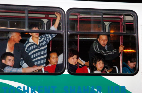Image: Tashkent residents are evacuated in a bus.