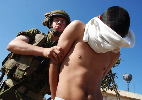 ARRESTED PALESTINIAN MAN IS TAKEN TO NAHAL OZ ARMY BASE