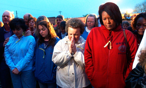 IMAGE: Friends and neighbors of Thomas Hamill, 43, gathered Sunday at the Noxubee County Courthouse.