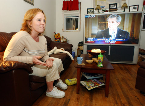 SOLDIER'S WIFE WATCHING BUSH PRESS CONFERENCE