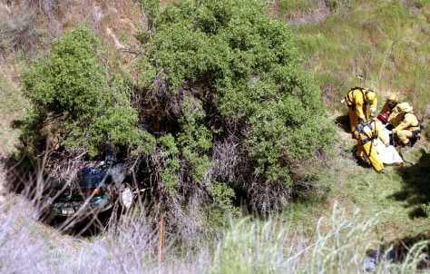 Image: Firefighters remove body from ravine.
