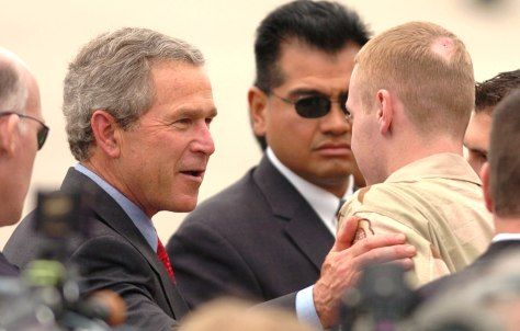 IMAGE: President Bush talks with Marine Spc. Robert Jackson in Des Moines