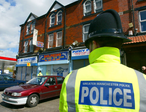 BRITISH POLICE GUARD RAIDED PROPERTY