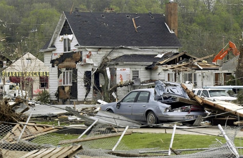 DEMOLISHED CARS AND HOME IN UTICA ILLINOIS AFTER TORNADOES RIPPED THROUGH AREA