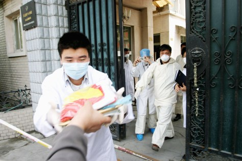 Image: Quarantined medical workers receive supplies.