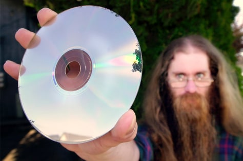Damaged CD held by user