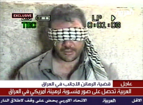 TV IMAGE FROM AL ARABIYA SHOWS U.S. HOSTAGE IN IRAQ