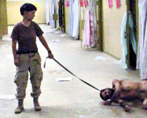SOLDIER HOLDS A LEASH OF AN IRAQI PRISONER IN IMAGES RELEASED BY THE WASHINGTON POST