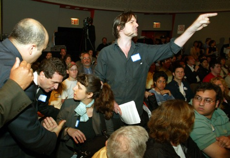 IMAGE: MAN SHOUTS FROM AUDIENCE DURING DISRUPTION OF SEPTEMBER 11 COMMISSION HEARING