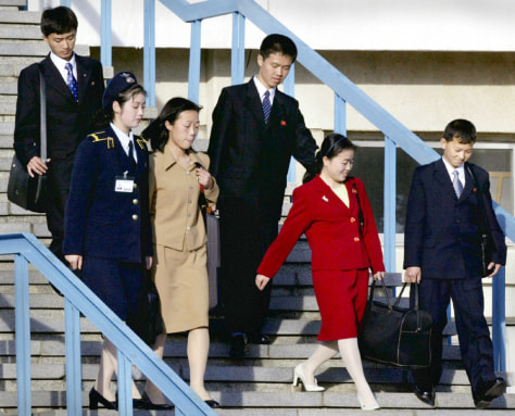 Image: Children of Japanese abductees are seen at Pyongyang airport.
