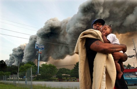 IMAGE: CONYERS, GA., RESIDENTS EVACUATE AS CHEMICAL WAREHOUSE BURNS