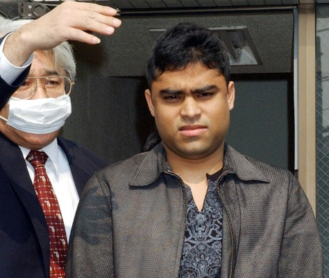 Image: Japanese investigator with man suspected of terrorism links.