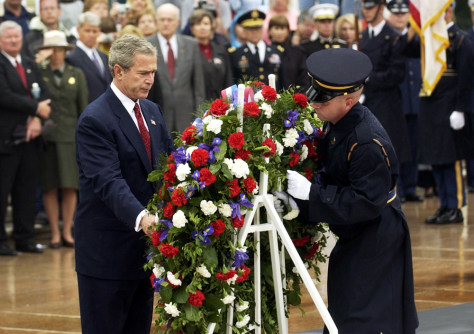 IMAGE: President Bush places a wreath Monday at the Tomb of the Unknowns at Arlington National Cemetery.