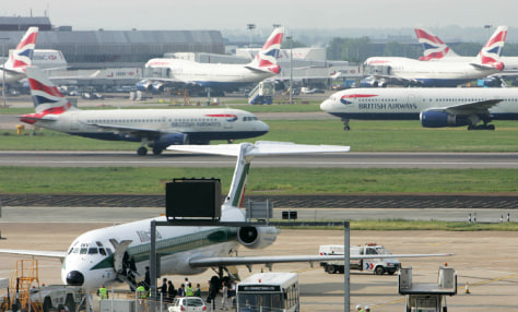 Image: Passengers board a plane at Heathrow airport.