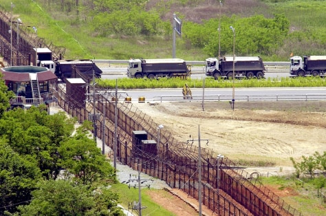 Image: South Korean trucks carrying sand at the Demilitarized Zone.
