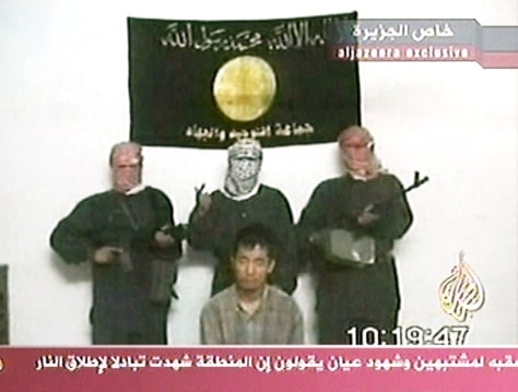 IMAGE: Kim Sun-il knelt in front of three captors in a videotape sent Sunday to Arab media.