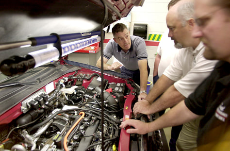 MECHANICS LOOK AT HYBRID ENGINE