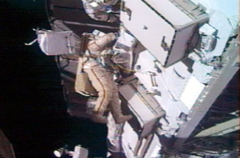 Padalka makes repairs on exterior of space station