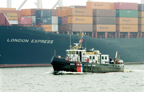 COAST GUARD BOAT PATROLS NEAR CARGO SHIP