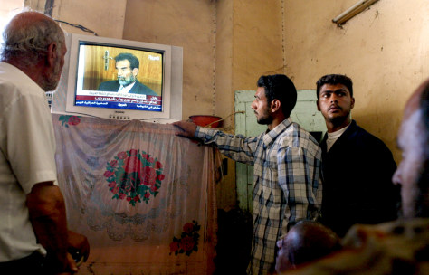Iraqi's Watch Saddam Hussein Appear In Iraqi Court