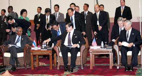 Image: U.S. Secretary of State Colin Powell, right, at a meeting in Jakarta, Indonesia.