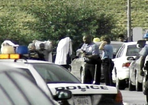 IMAGE: Police interview witnesses outside the ConAgra plant in Kansas City, Kan.