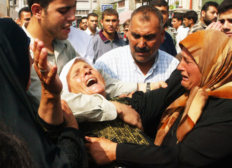 Image: Mother of dead Palestinian militant weeps.
