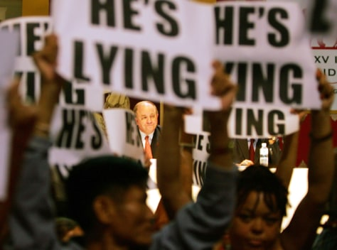 US GLOBAL AIDS COORDINATOR TOBIAS WATCHES AS PROTESTERS CARRY SIGNS AT AIDS CONFERENCE IN BANGKOK