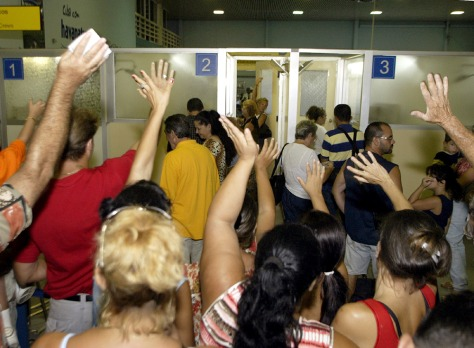 CUBANS WAVING GOOD BYE TO CUBAN AMERICAN FAMILY MEMBERS AT HAVANA'S AIRPORT