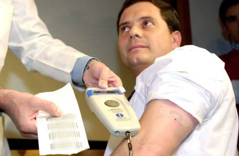 Mexican man scanned to show code on his implanted chip