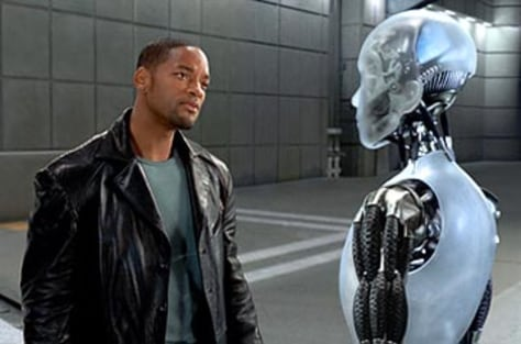 Will Smith stares at a humanoid robot
