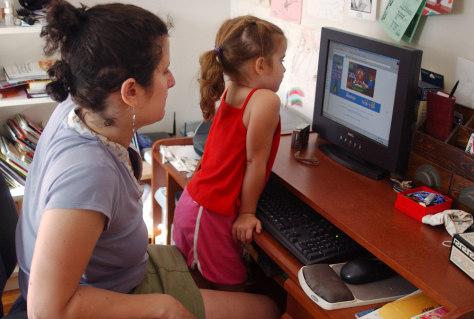 Mother and daughter at computer