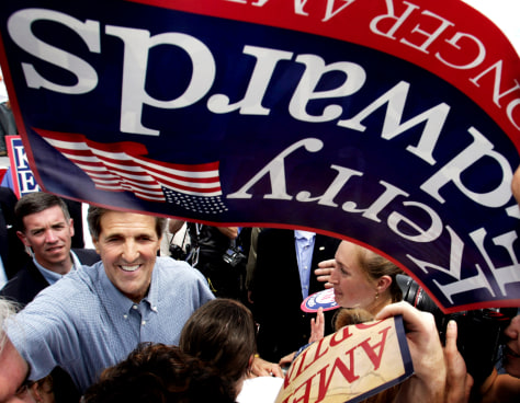 Democratic presidential candidate Kerry reaches out into the crowd at a rally