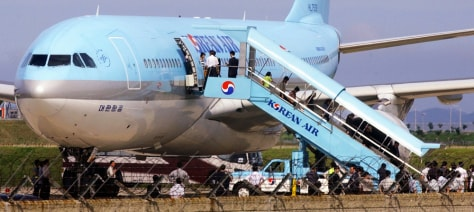 Image: North Korean refugees arrive in South Korea.