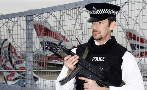 Image: A policeman patrols Heathrow Airport in London.