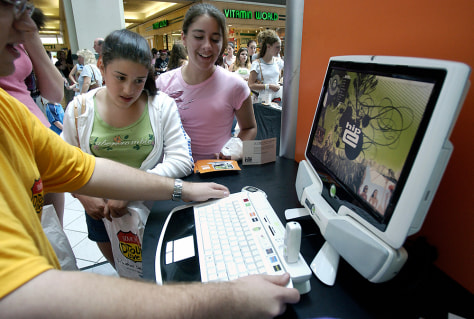 young teens watch demo of hip-e computer